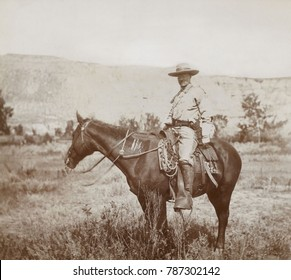 Young Theodore Roosevelt on his favorite hunting pony in the Badlands of North Dakota, 1885. He is wearing a ranch costume during a cattle roundup near Medora, North Dakota. Photo by Truman Ward Inger