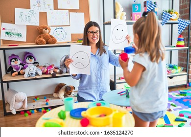 Young therapist woman speaking and treating child, counselor and behaviour correction at pedagogue payroom showing happy and sad faces