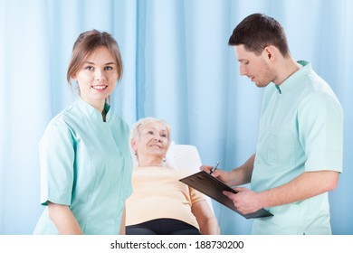 Young therapists doing medical examination before massage