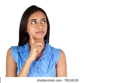 Young thoughtful business woman over white background.