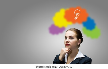 Young thoughtful businesswoman and colorful speech bubbles above