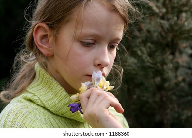 Young thoughtful girl with a bunch of crocuses