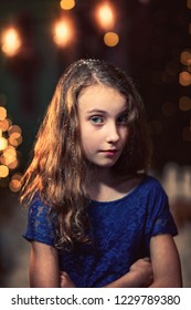 young thoughtful girl in an elegant dress in a winter evening outdoors