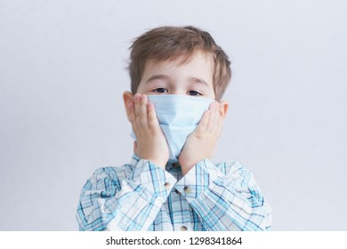 young three year old boy in medical mask, concept of quarantine and protection from polluted air