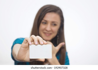 Young with thumb up, holding credit card