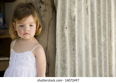 young toddler in  a country shed