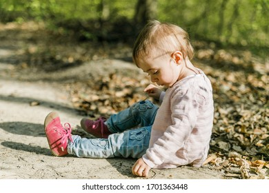 young toddler playing in the forest