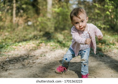 young toddler playing in the forest, start running