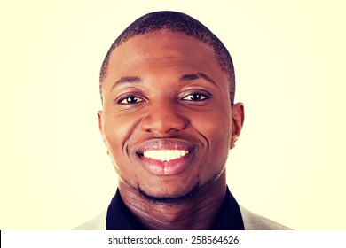 Young toothy smiling african businessman.