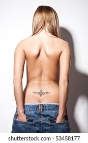 young topless woman dressed in man jeans