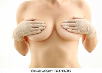 Young Topless Woman Hold Naked Breasts Portrait. Female Hiding Breast on White Background. Girl Body Healthcare and Surgery. Beautiful Skin. Bust Improvement with Implant Partial View Shot