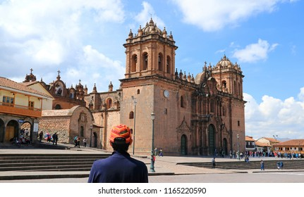 Young Tourist Admiring the Marvelous Cusco Cathedral on Plaza de Armas, Cusco, Peru, South America