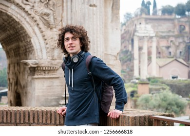 Young tourist with backpack sightseeing in Rome