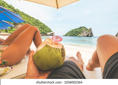 Young Tourist Couple Relaxing on Sandy Beach at Tropical Paradise Island. Gopro First Person View. POV. Nusa Penida, Bali, Indonesia.