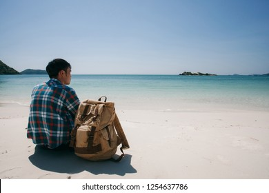 young tourist traveler with backpack ready for summer beach outdoor adventure