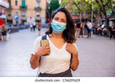 young tourist wearing face mask sightseing in european city. traveling and tourism industry during the corona virus pandemic and covid19 disease, affected by the global crisis - Shutterstock ID 1766295629