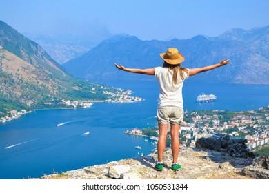 Young tourist woman enjoying a view of Kotor Bay, Montenegro