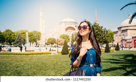 Young tourist woman in front of Blue Mosque. Istanbul, Turkey