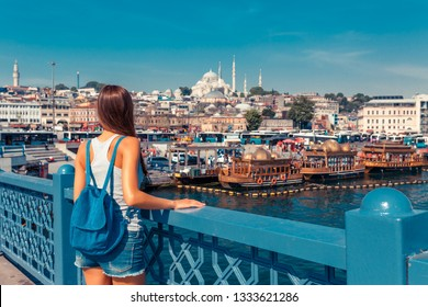 Young tourist woman on Galata bridge, Golden Horn bay, Istanbul. Panorama cityscape of famous tourist destination Bosphorus strait channel. Travel landscape Bosporus, Turkey, Europe and Asia.
