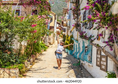 Young tourist woman walking on the streets in the center of Kalkan, Turkey