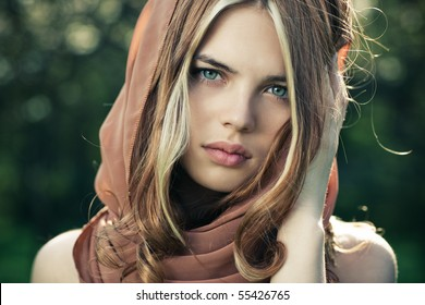 Young tranquil woman outdoors portrait.