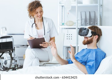 Young trauma patient wearing virtual reality glasses in hospital