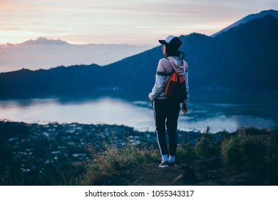 young travel girl posing in volcano, Girl travel in mountains alone. Spring weather, calm scene. Backpacker walking outdoors, view over landscape in sunlight. Wanderlust photo series.