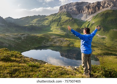 Young travel man enjoying mountain view at sunset. Concept of extreme sport and active life