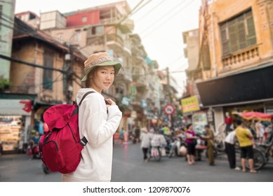 Young traveler with backpack at old quarter Hanoi, Vietnam