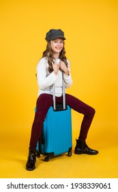 young traveler. concept of travelling. childhood happiness. ready for vacation trip. adventure. happy teen girl with bag. spring kid fashion style. child with travel suitcase wearing trendy hat
