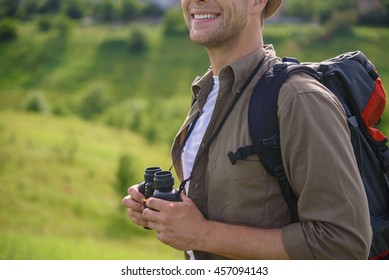 Young traveler enjoying vacation on field