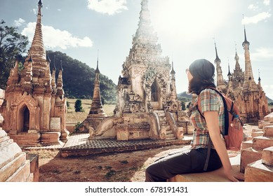 Young traveler enjoying a view at Buddhist stupas. Myanmar, Asia. 