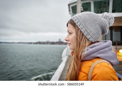 Young traveler girl looking at the sea, Helsinki, Finland