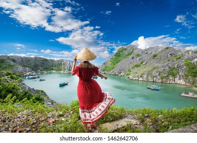 A young traveler girl on the top of mountain in Long Chau island, Cat Ba and enjoy the beauty of seascape. Young girl love wild life, travel, freedom.