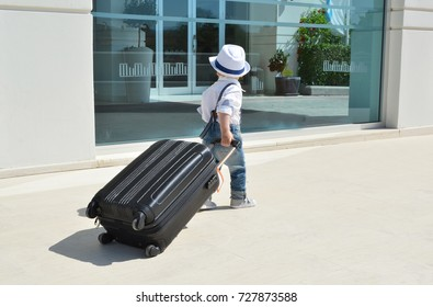 Young traveler with a suitcase