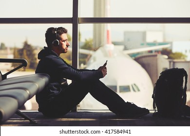 Young traveler is waiting at the airport