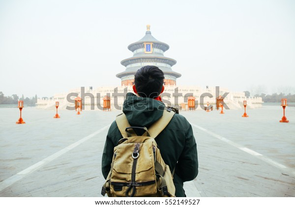Young traveler walking towards temple of heaven - in Beijing, China. Asia Travel