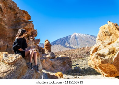 Young traveler woman enjoy beautiful view of Teide volcano in Tenerife. Spain. Canary Islands. Travel concept