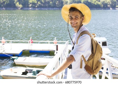 young traveller with the backpack at the jetty