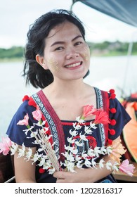 Young traveller girl with Tanaka on her smile face is happiness. Tanaka is a yellowish-white cosmetic paste made from ground bark.