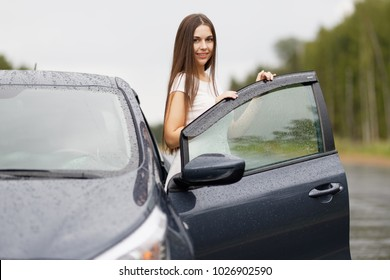 Young traveller woman standing outside car outdoor