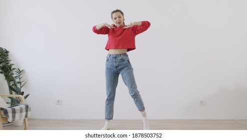 Young trendy woman dancing at home. Social media concept