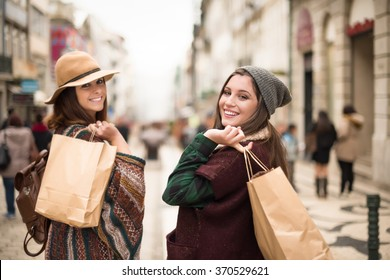 Young trendy women shopping in the city