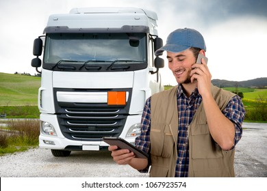 Young truck driver with tablet