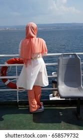 Young Turkish woman with scarf  on Gallipoli ferry, near Cannakale,  Turkey