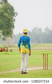 A young umpire of a cricket match isolated unique photo