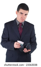 young unhappy businessman with money and empty wallet