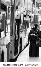 A young unidentified Muslim woman has trouble getting on a bus in Fenchurch Street, London, EC3 on 25th June 2015