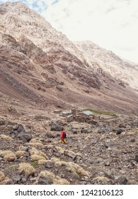 Young unrecognisable man trekking above refuge Toubkal in the High Atlas, Morocco