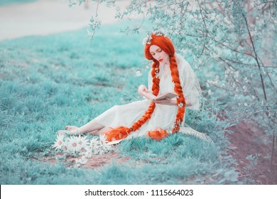 Young unusual redhead renaissance girl with curly hair braided in plait on a spring background. Beautiful woman with pale skin and in a renaissance dress reads a book in a meadow. Spring flowers
